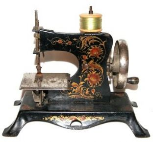 #75 Casige 25 Toy Sewing Machine